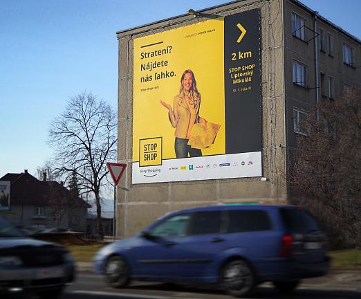 StopShop - Banner na fasáde budovy napnutý v lankovom ráme